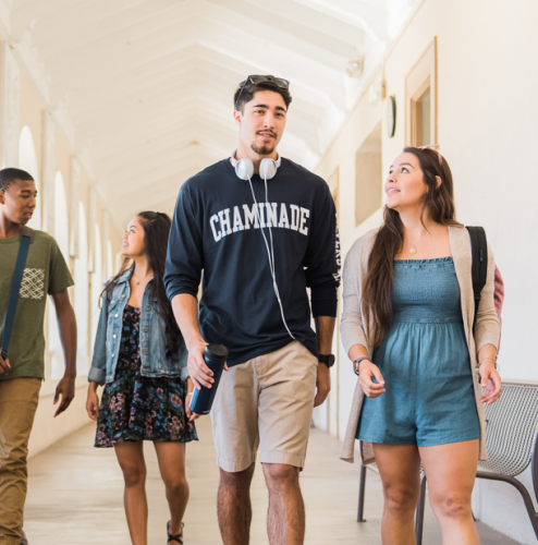 Chaminade University students chat as they walk through Henry Hall