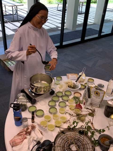 Sister Malia Wong making natural ointments