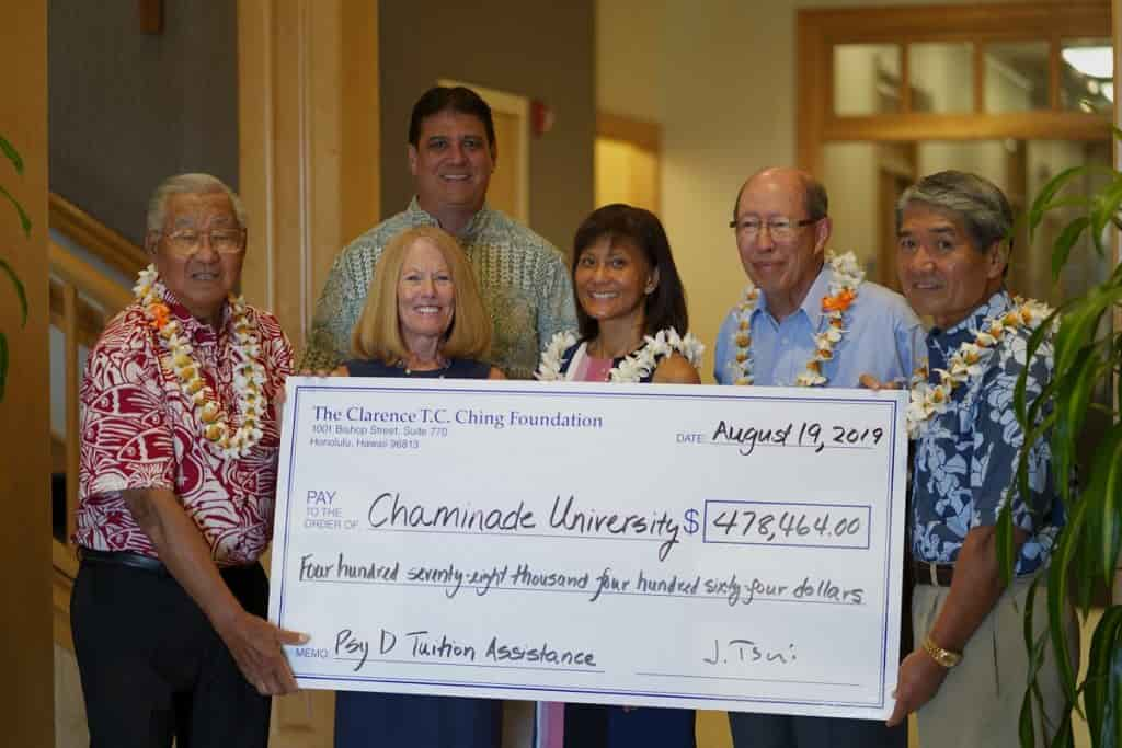 Group picture receiving check from Clarence T.C. Ching Foundation to provide scholarships to students