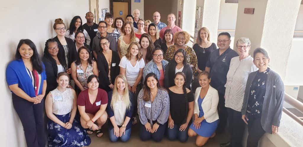 Master of Science in Counseling Psychology students and faculty pose for a group picture during new student orientation