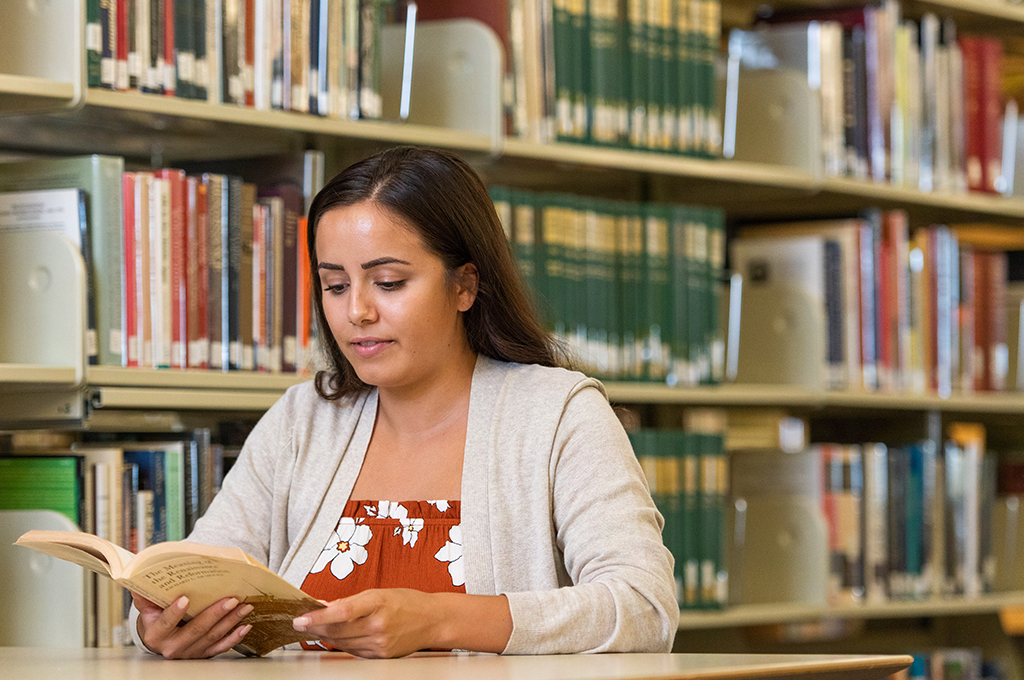 a student studying at library