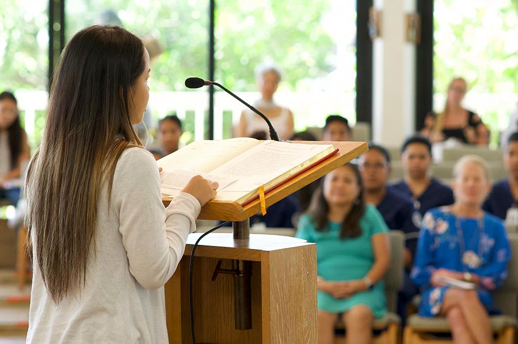 person talking at podium