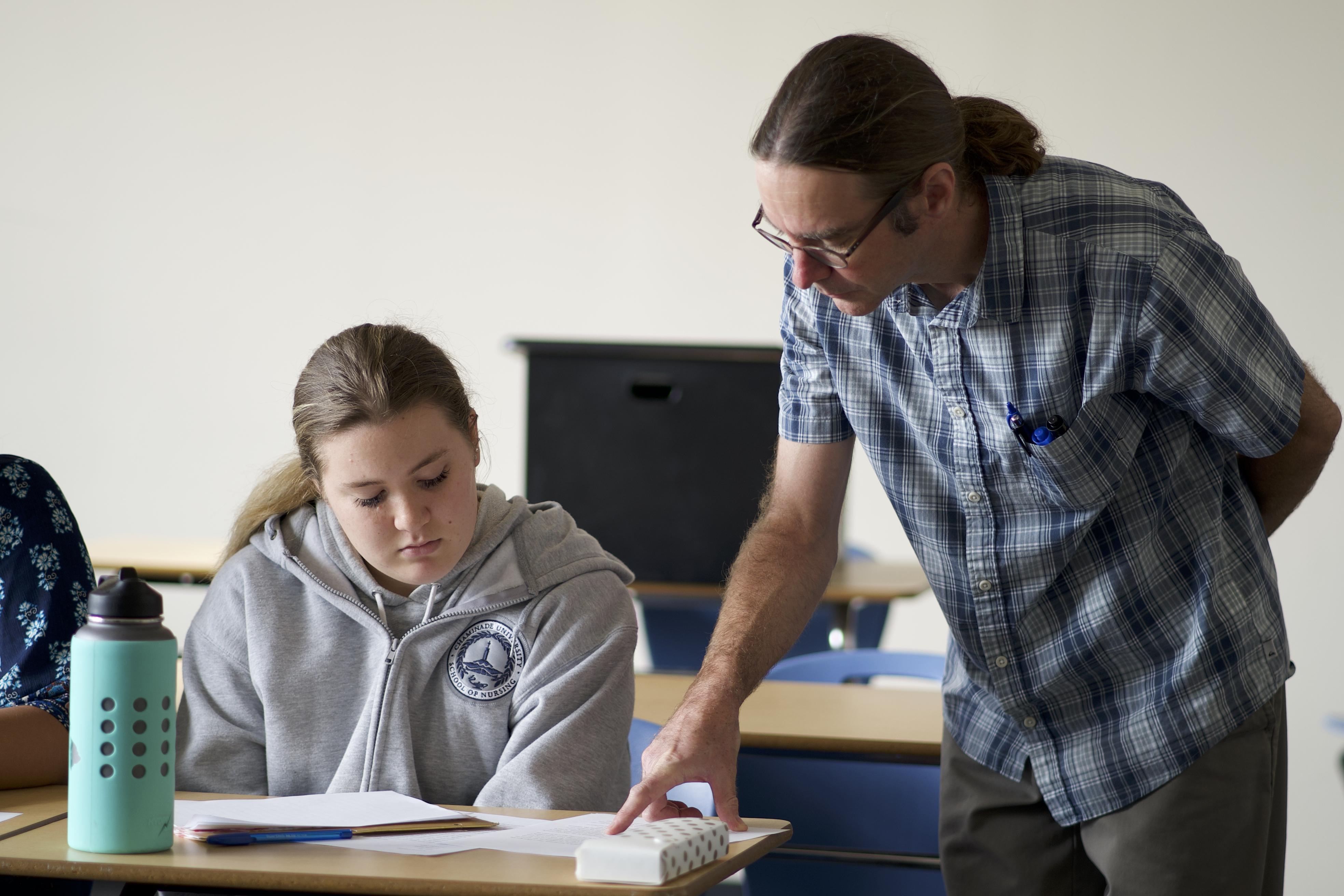 professor teaching a student