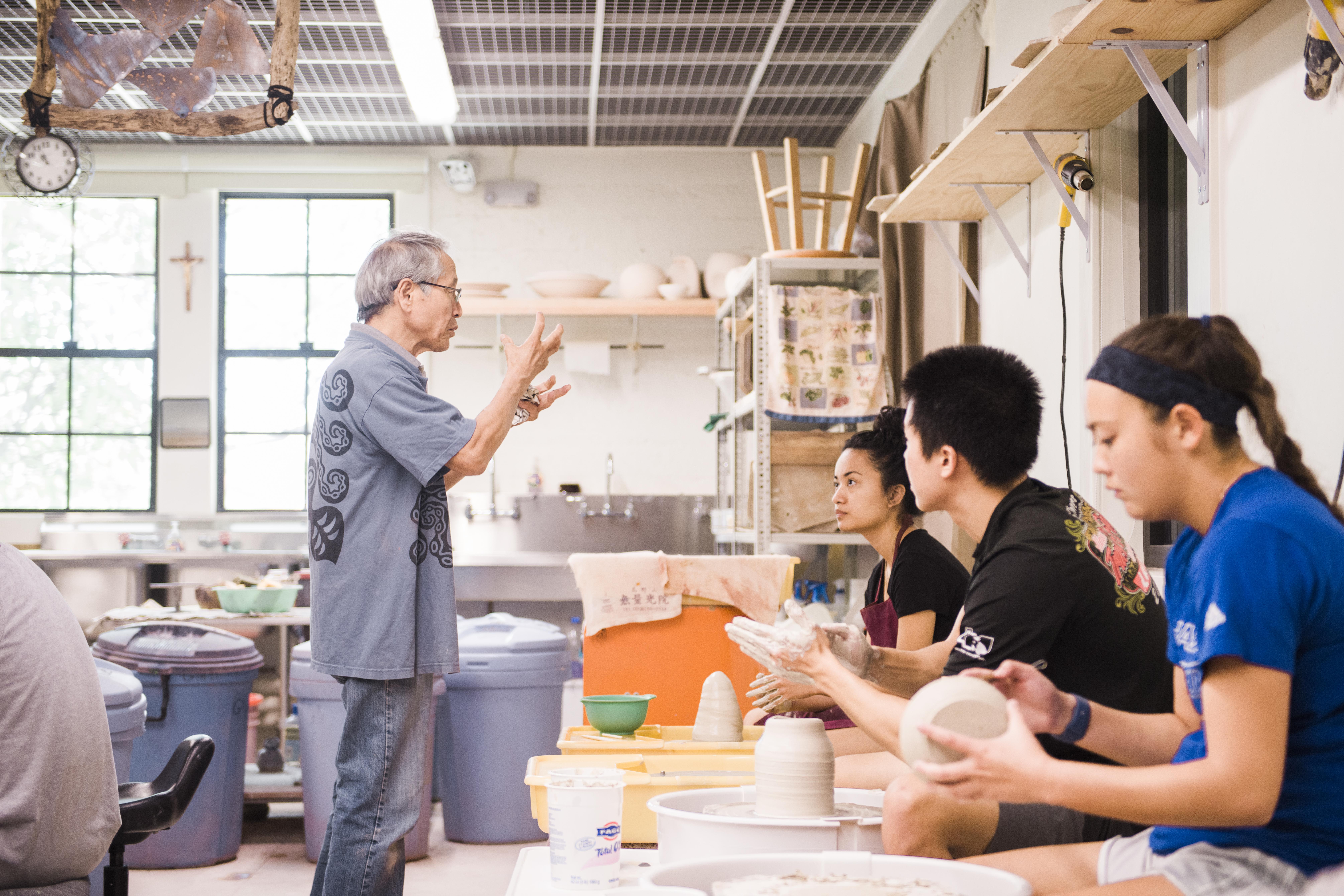 professor teaching students in fine art class