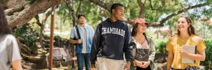 Chaminade students walking and talking to class