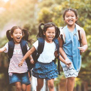 Three elementary students running