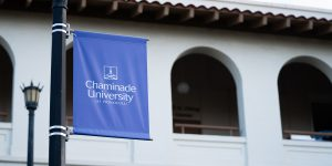 Chaminade University of Honolulu flag in front of Clarence T.C. Ching Hall building