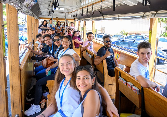 New students on a trolley taking a tour of Kaimuki during New Student Orientation