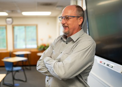 Dr. Dale Fryxell (dean, School of Education and Behavioral Sciences) standing in classroom