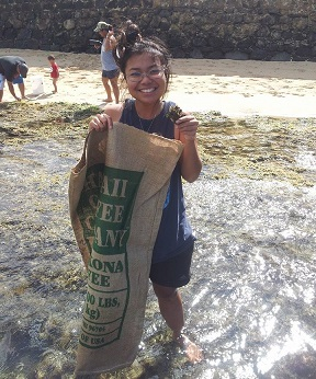 Nicole Yamase '14 being a part of a beach clean up