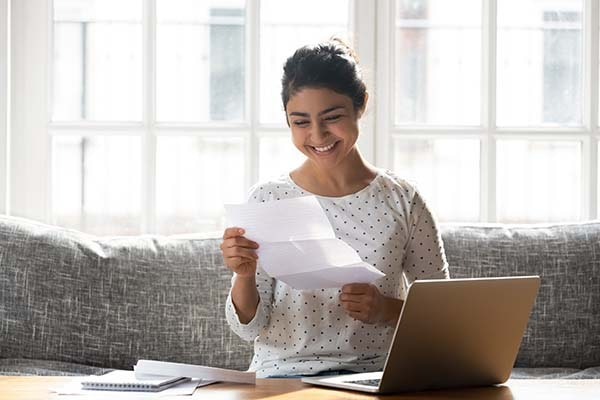 cheerful student female looking at document