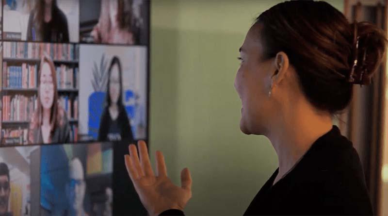 graduate professor teaching a graduate course online through video conferencing