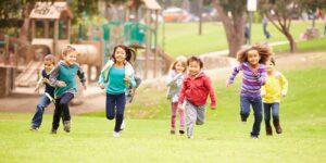 kids in school running to teacher