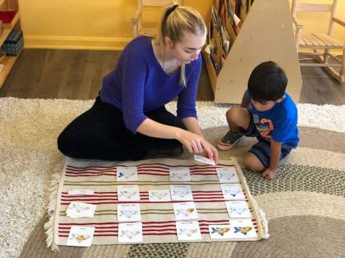 Emily Yerington, MAT '19, sitting with a student teaching