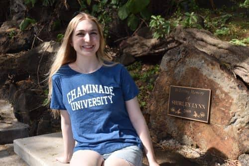 Emily Yerington, MAT '19, wearing a Chaminade shirt and smiling at camera