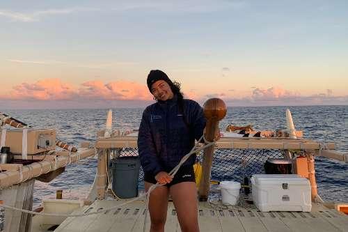 Lucy Lee '23, environmental studies major navigating on Hokulea