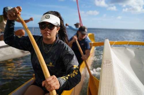 Lucy Lee '23, environmental studies paddling on Hikianalia