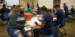 Chaminade nursing students participating in a mock vaccination clinic