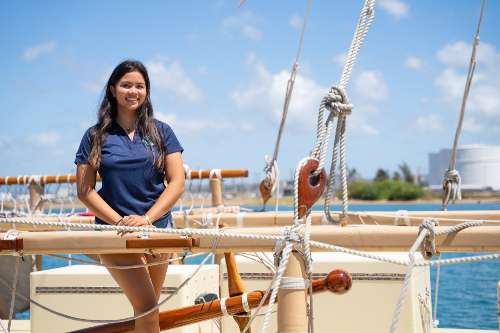 Lucy Lee '23, environmental studies major on Hokulea smiling at camera